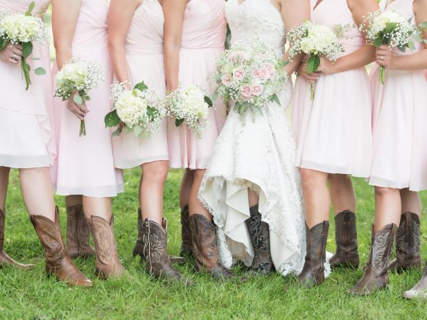 Bridal Party Boot Photo Showcasing Soft Pink Dresses and Hydrangea and Baby's Breath Bridesmaid Bouquets