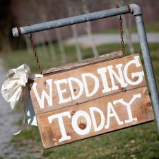 Wooden Wedding Welcome Sign With Cream Paint Print Hung on Metal Piping