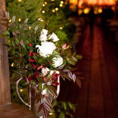 White Rose, Winter Greenery and Red Berry Wedding Centerpiece in Antique Silver Vase