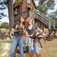 The Junk Gypsies pose with design pieces to use in a rustic treehouse.