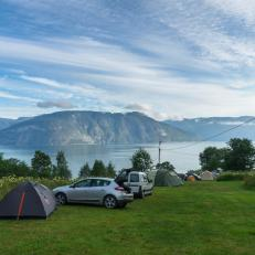 Fjord camping area with cars and tents
